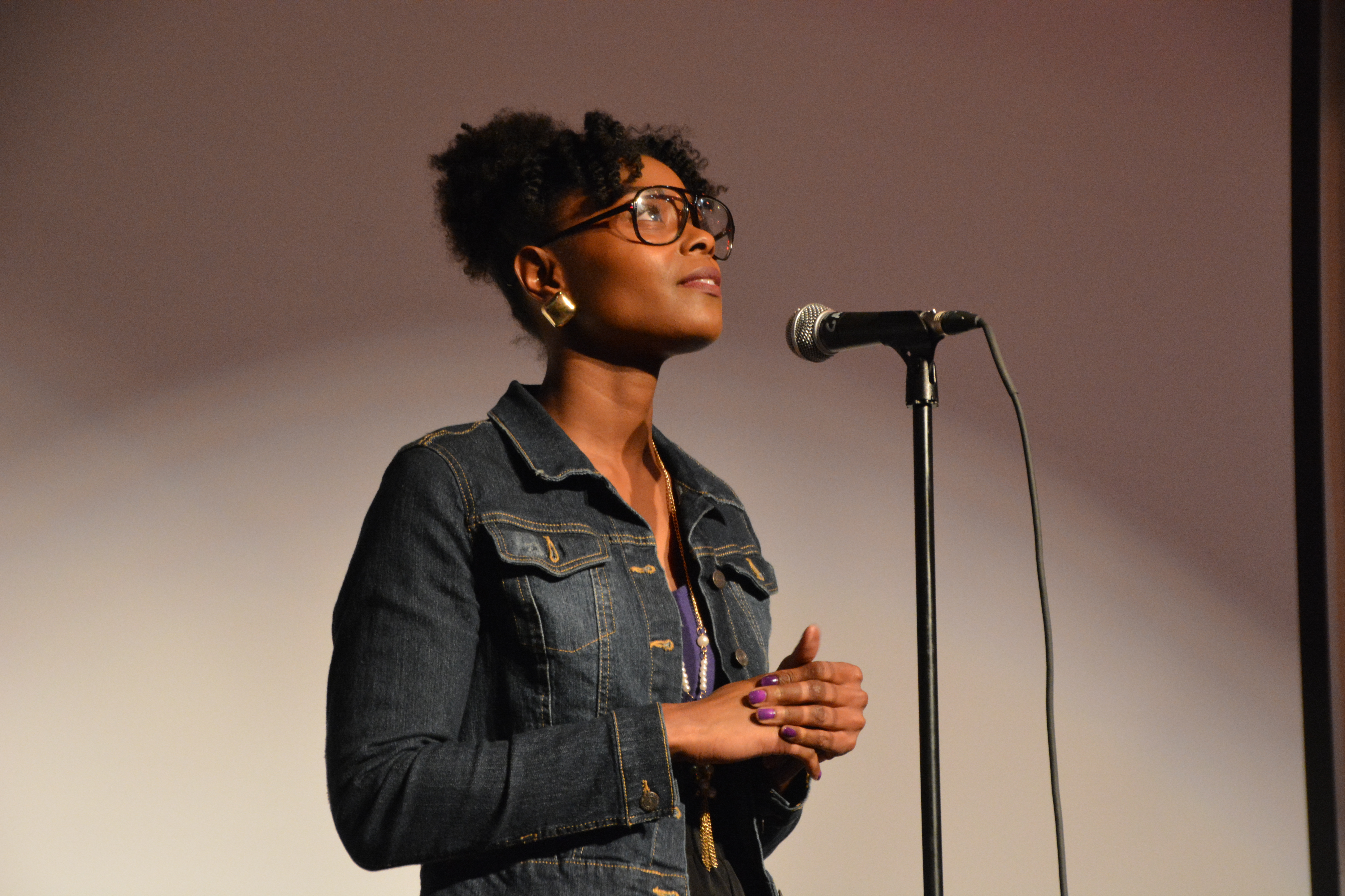 Poetry artist at the Spoken Word Open Mic & Poetry Slam Contest.