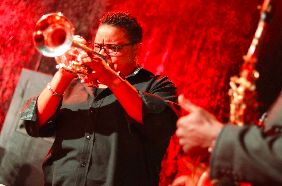 Trumpet player performs at Dan's Silverleaf in Denton, Texas, for the festival's Funk Night. The room is set in red light.